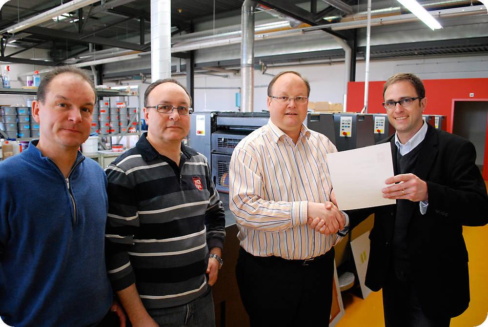 Grafimedia Druck AG als erste Schweizer Druckerei swissPSO zertifiziert.